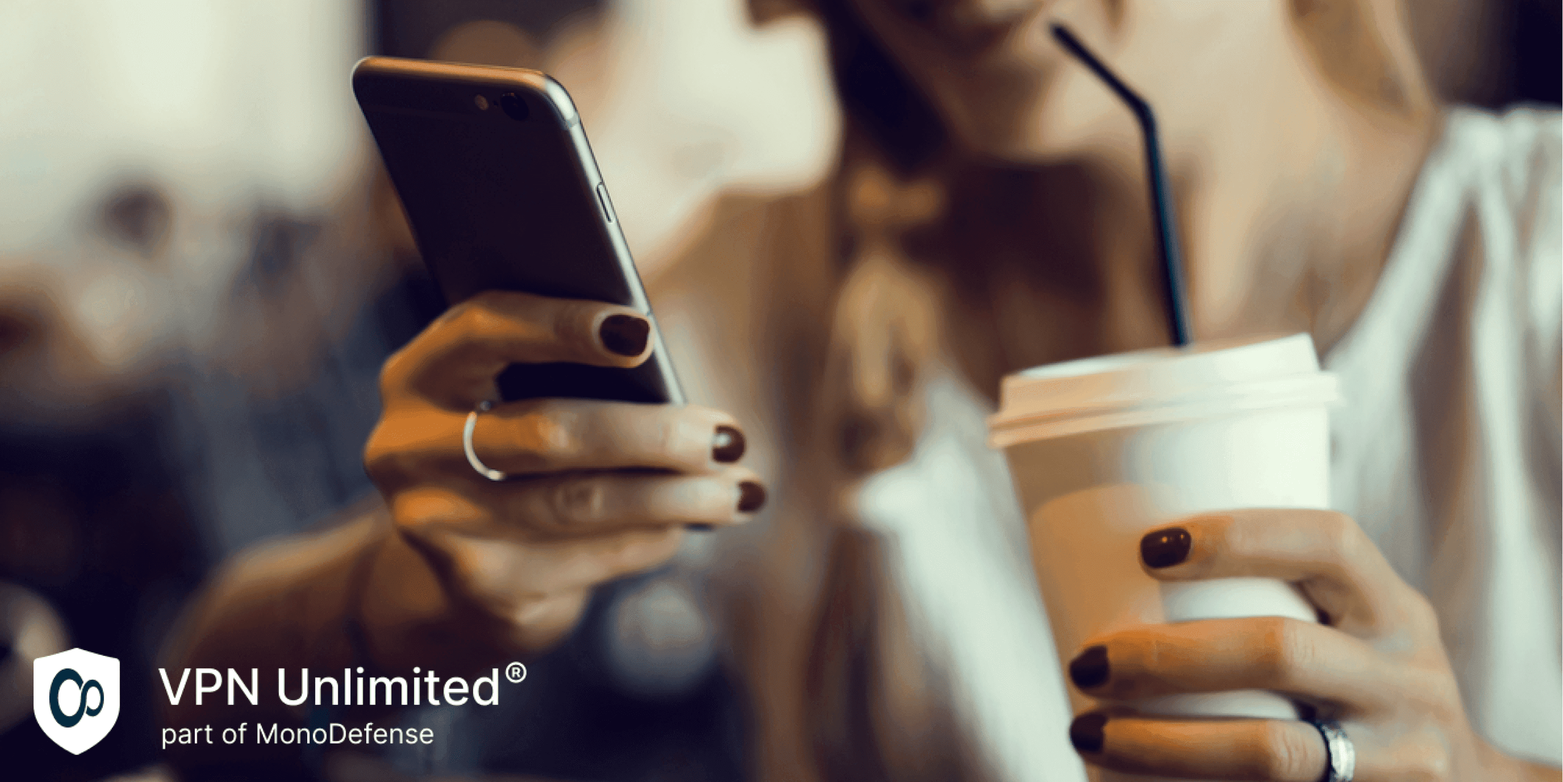 Woman in cafe using iPhone connected to public WiFi, concept of online protection with VPN on free WiFi
